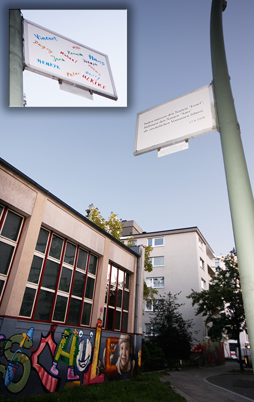 The so-called 1938 Regulation of Name Changes stated that Jews – many of whom had German names – had to adopt middle names: Sara for women and Israel for men. This sign is located near a school. - <em>by SL Wong</em>