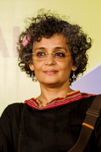 """""""<a href=""""https://commons.wikimedia.org/wiki/File:Arundhati_Roy_W.jpg#mediaviewer/File:Arundhati_Roy_W.jpg"""">Arundhati Roy W</a>"""" by <a href=""""//en.wikipedia.org/wiki/User:Bellus_Delphina"""" class=""""extiw"""" title=""""w:User:Bellus Delphina"""">Augustus Binu</a>/ <a rel=""""nofollow"""" class=""""external text"""" href=""""https://www.facebook.com/DreamSparrowPhotography"""">facebook</a> - <span class=""""int-own-work"""">Own work</span>. Licensed under <a title=""""Creative Commons Attribution-Share Alike 3.0"""" href=""""http://creativecommons.org/licenses/by-sa/3.0"""">CC BY-SA 3.0</a> via <a href=""""//commons.wikimedia.org/wiki/"""">Wikimedia Commons</a>."""