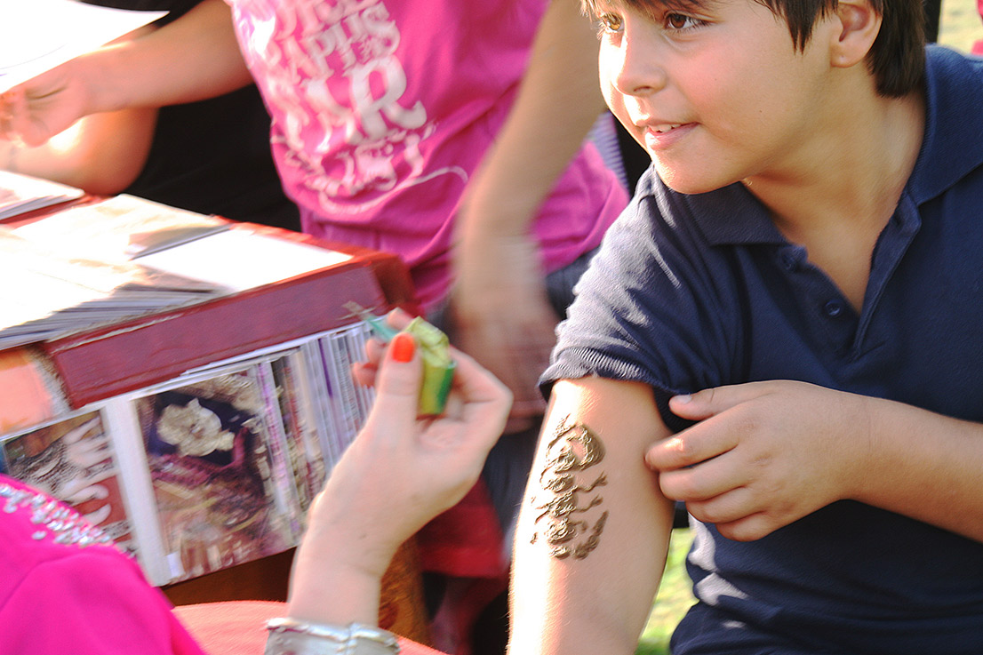 A happy henna'ed client. - <em>by S.L. Wong</em>