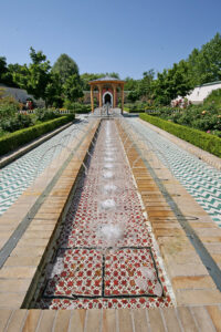 Colourful tiles, fountains and fruit trees adorn the garden courtyard. - <em>by SL Wong</em>