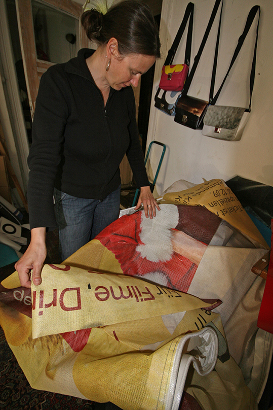 Giant banners that would otherwise be discarded find a longer life cycle thanks to Britta. - <em>by SL Wong</em>