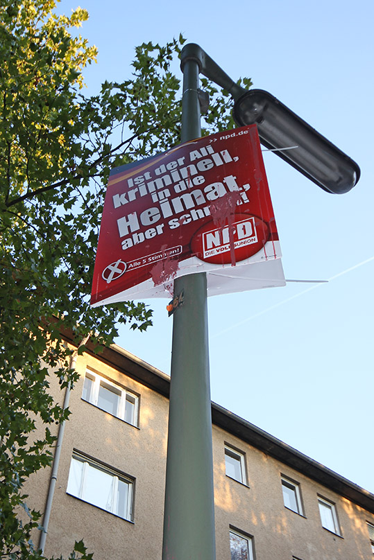 """This 2011 extreme right wing NPD election poster read: """"Send Ali the criminal quickly back to his homeland"""". It was defaced with paint. - <em>by SL Wong</em>"""