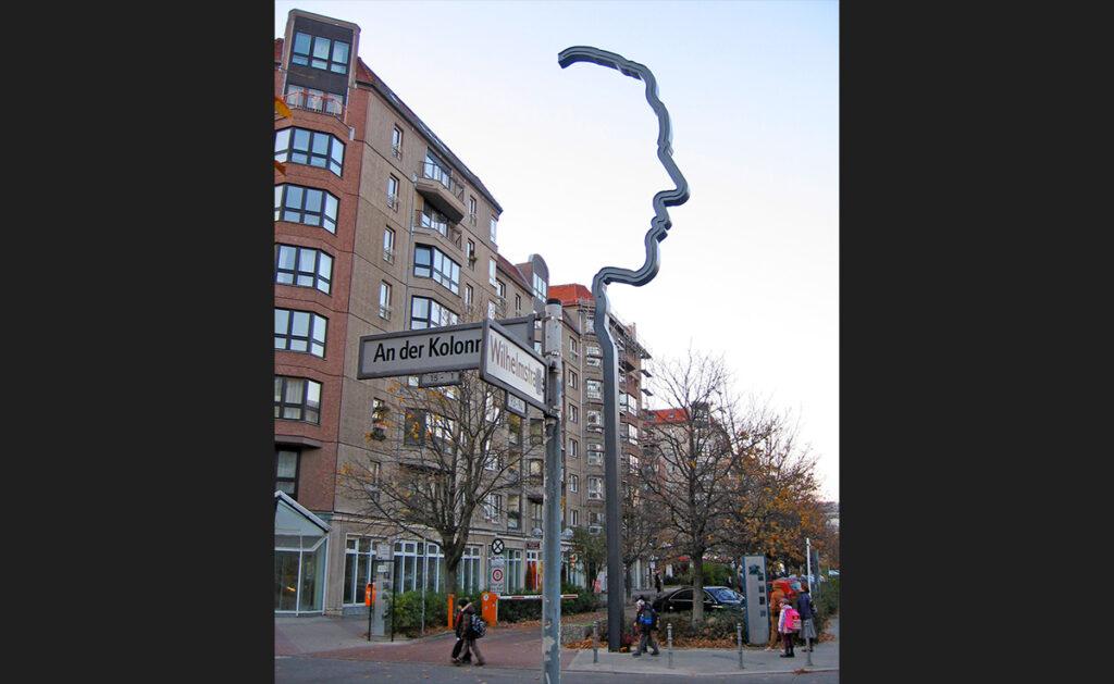 Apartment blocks, trees, historical markers and signboards clutter Wilhelmstraße. - <em>by SK Mandal</em>