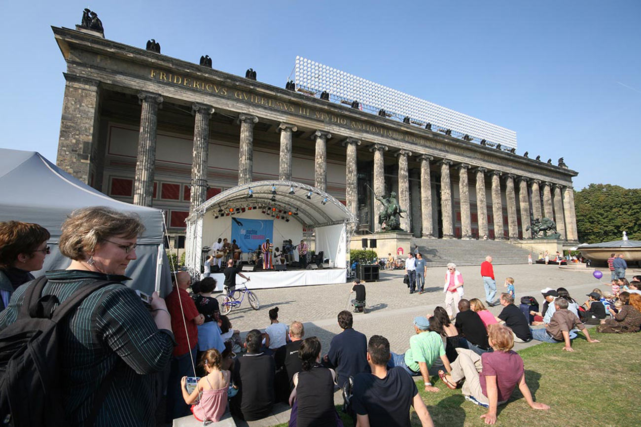 The neoclassical Altes Museum is backdrop to a Muslim festival. - by S.L. Wong
