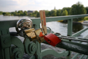 The metal bridge is now beloved by visitors, sometimes literally, as these love-locks indicate. - <em>by SL Wong</em>