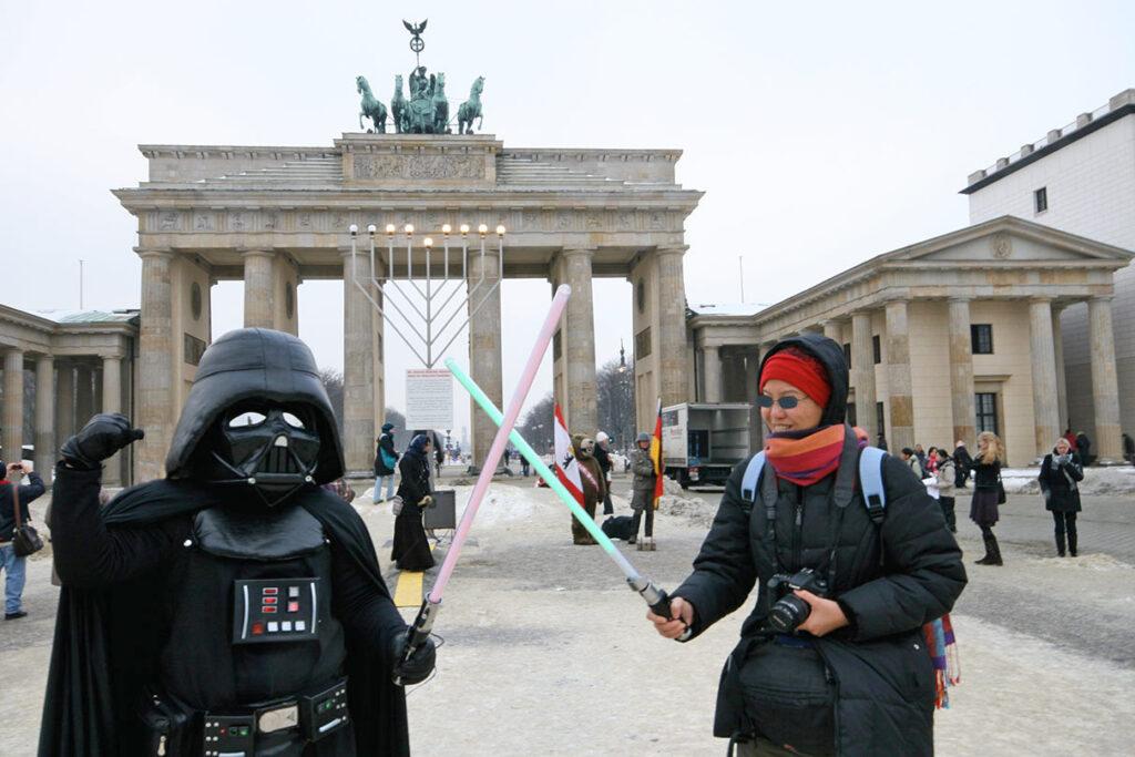 Darth Vader duels with a fan at the Brandenburger Tor. - <em>by SL Wong</em>