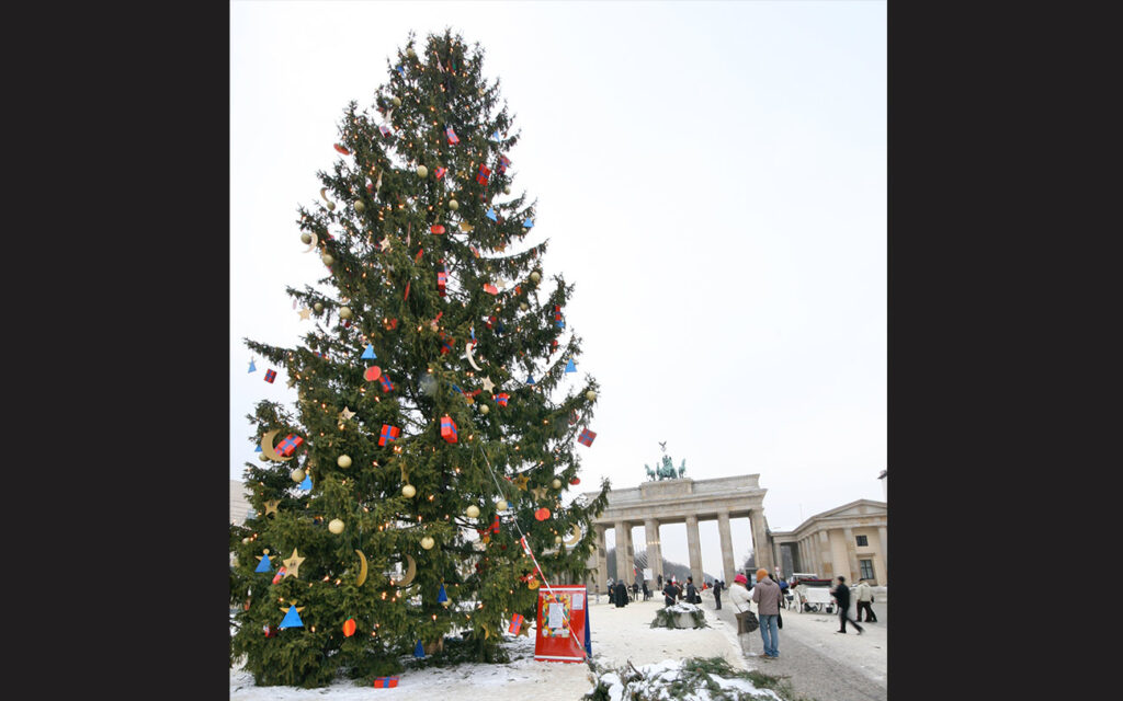 A giant Christmas tree is a fixture at the Brandenbuger Tor each Christmas. - <em>by SL Wong</em>
