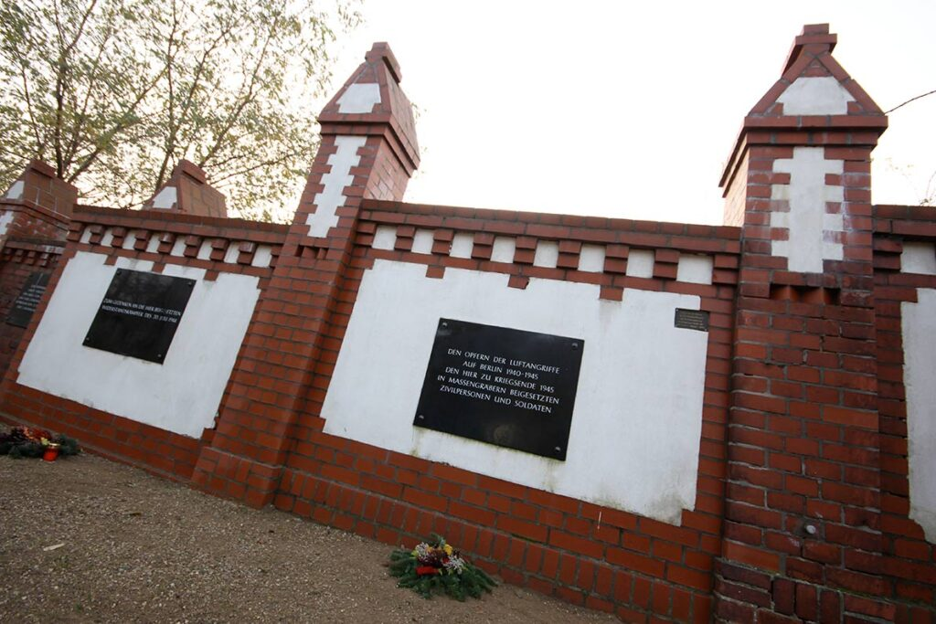 WWII dead are commemorated on the old cemetery wall that was partially reconstructed in 2002. - <em>by SL Wong</em>